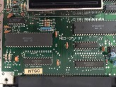 """Here we take a close up at the circuit board, the two large chips are the Picture Prossesing Units or PPUs, note that this unit was manufactured in 1987. Right on top of the date you will see what they call the """"Expansion Slot"""" which was apparently never used"""